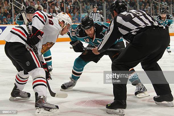 Jonathan Toews of the Chicago Blackhawks takes a faceoff against Joe Thornton of the San Jose Sharks in Game One of the Western Conference Finals...