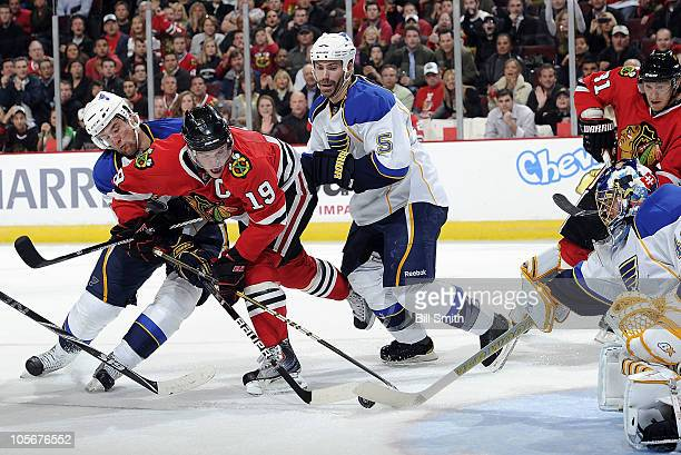 Jonathan Toews of the Chicago Blackhawks tries to get the puck past goalie Jaroslav Halak of the St. Louis Blues, as Alex Pietrangelo and Barret...
