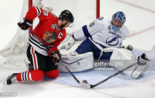 Jonathan Toews of the Chicago Blackhawks tries to score against Ben Bishop of the Tampa Bay Lightning in the second period of Game Six of the 2015...