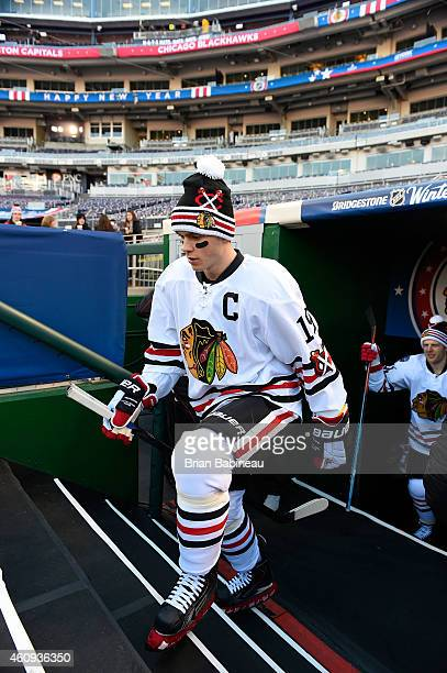 Jonathan Toews of the Chicago Blackhawks walk out of the locker room to take the ice during practice day prior to the 2015 Bridgestone NHL Winter...