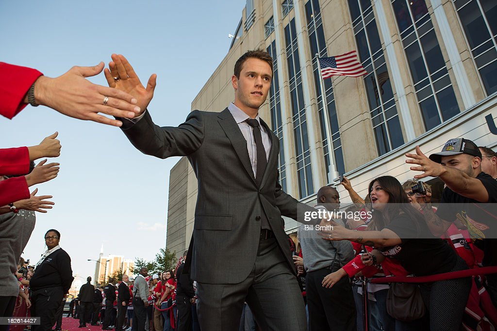 Jonathan Toews #19 of the Chicago Blackhawks walks down the red carpet before the Blackhawks home opener against the Washington Capitals on October 1, 2013 at the United Center in Chicago, Illinois.
