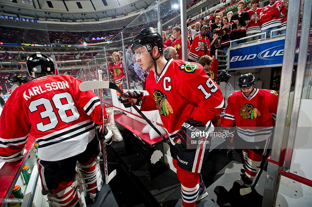 Jonathan Toews #19 of the Chicago Blackhawks walks out to the ice, as teammate Brent Seabrook #7 follows behind, before Game Five of the Western Conference Quarterfinals against the Minnesota Wild during the 2013 Stanley Cup Playoffs at the United Center on May 09, 2013 in Chicago, Illinois.
