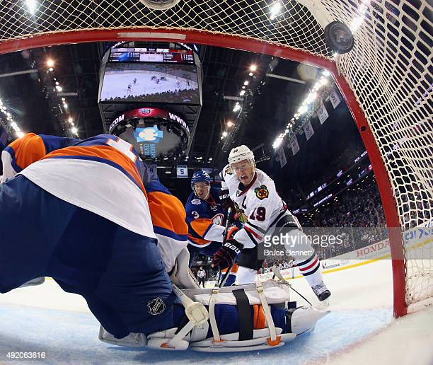Jonathan Toews of the Chicago Blackhawks watches a shot by Patrick Kane go into the net at 149 of overtime against Thomas Greiss of the New York...
