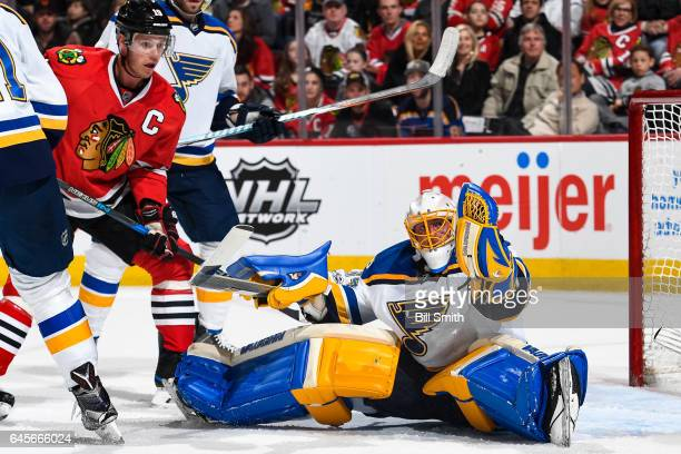 Jonathan Toews of the Chicago Blackhawks watches as goalie Jake Allen of the St Louis Blues gloves the puck in the first period at the United Center...