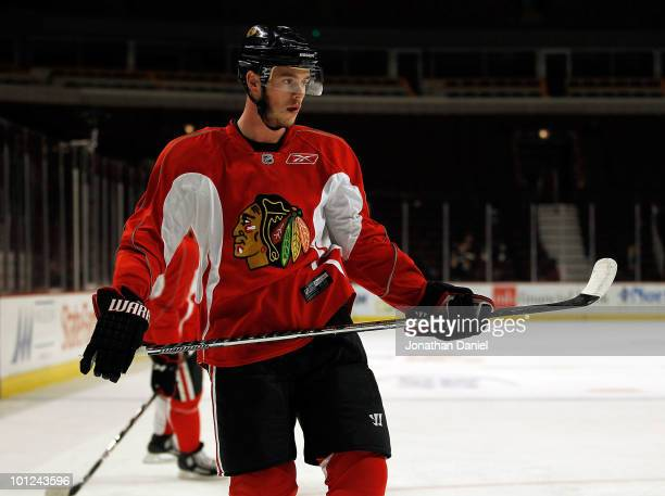 Jonathan Toews of the Chicago Blackhawks watches as teammates shoot the puck during Stanley Cup practice at the United Center on May 28 2010 in...