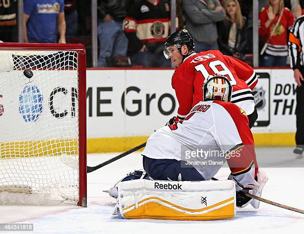 Jonathan Toews of the Chicago Blackhawks watches his shootout goal sail over Roberto Luongo of the Florida Panthers at the United Center on February...