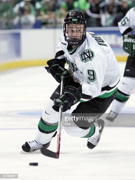 Jonathan Toews of the North Dakota Fighting Sioux moves the puck against the Boston College Eagles during the NCAA Frozen Four on April 6, 2006 at...