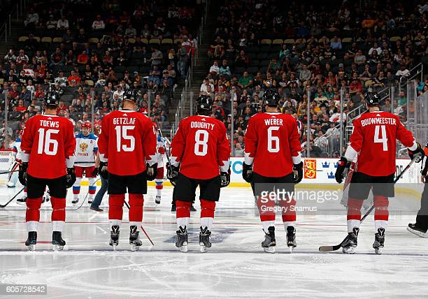 Jonathan Toews Ryan Getzlaf Drew Doughty Shea Weber and Jay Bouwmeester of Team Canada stand during the National Anthems against the Team Russia at...