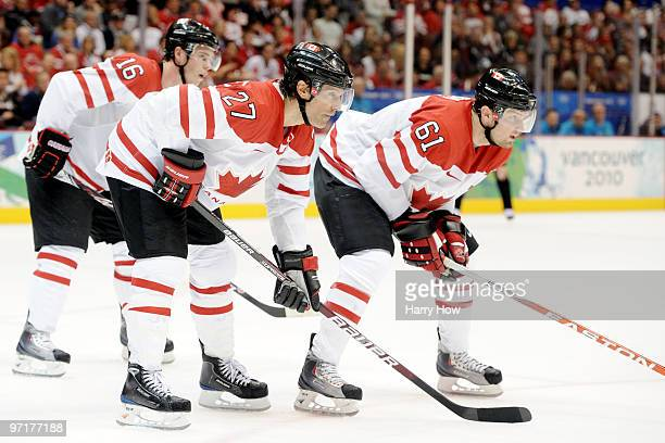 Jonathan Toews Scott Niedermayer and Rick Nash of Canada await a face off during the ice hockey men's gold medal game between USA and Canada on day...