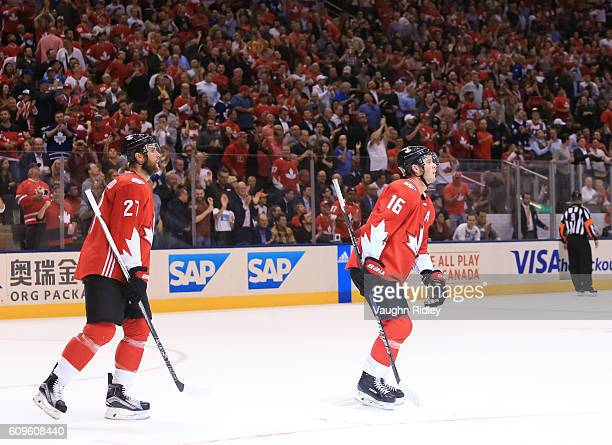 Jonathan Toews skates to the bench with Alex Pietrangelo of Team Canada after scoring a second period goal on Team Europe during the World Cup of...