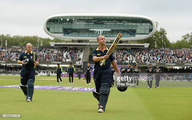Jonathan Trott and Tim Ambrose of Warwickshire leaves the field after winning the Royal London oneday cup final cricket match between Warwickshire...