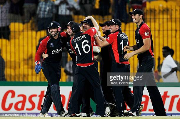 Jonathan Trott of England celebrates victory with team mates after his throw from the deep contributed to the run out to win the match during the...