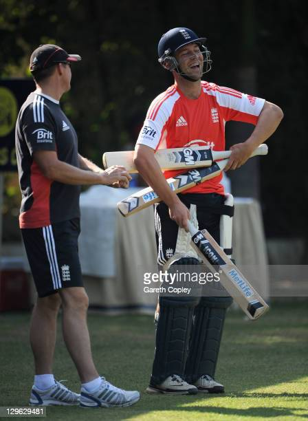 Jonathan Trott of England shares a joke with coach Andy Flower during a nets session at The Punjab Cricket Association Stadium on October 19 2011 in...