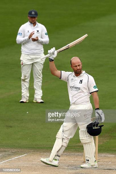 Jonathan Trott of Warwickshire acknowledges the crowd after reaching a century during day two of the Specsavers County Championship Division Two...