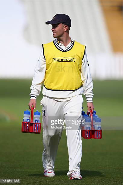 Jonathan Trott of Warwickshire carries the drinks on for team mates during the friendly match between Warwickshire and Gloucestershire at Edgbaston...