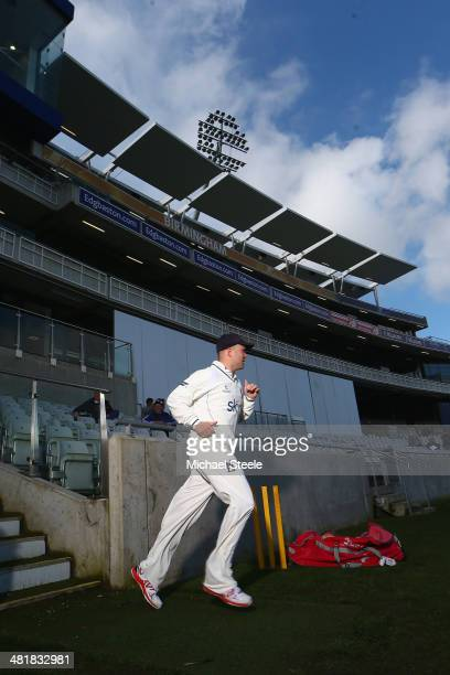 Jonathan Trott of Warwickshire takes to the field making his first senior appearance since the tour of Australia during the friendly match between...