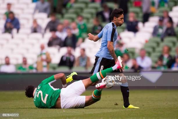 Jonathan Urretaviscaya of Uruguay fouled by Cyrus Christie of Ireland during the International Friendly match between Republic of Ireland and Uruguay...