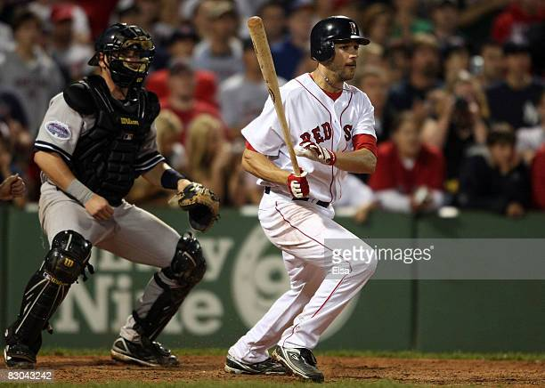 Jonathan Van Every of the Boston Red Sox drives in the game winning run as Francisco Cervelli of the New York Yankees defends on September 28, 2008...