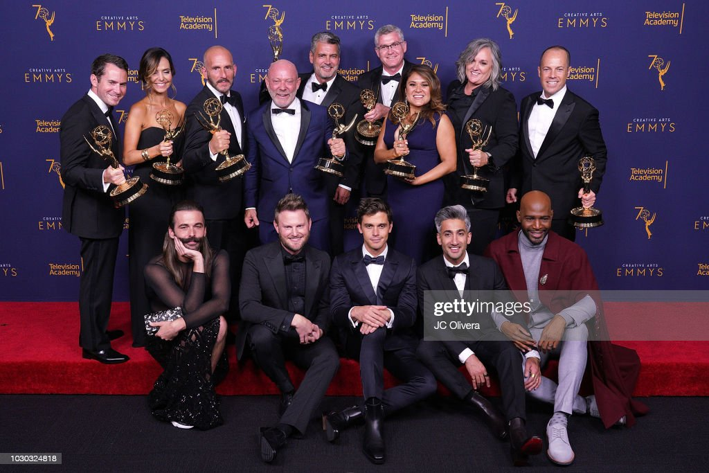 Jonathan Van Ness, Bobby Berk, Antoni Porowski, Tan France, Kamaro Brown, and David George, (Back L-R) Jordana Hochman, Rob Eric, David Collins, Michael Williams, David Eilenberg, Rachelle Mendez, Jennifer Lane, Adam Sher, winners of the award for outstanding structured reality program for 'Queer Eye' pose in the press room during the 2018 Creative Arts Emmy Awards at Microsoft Theater on September 9, 2018 in Los Angeles, California.