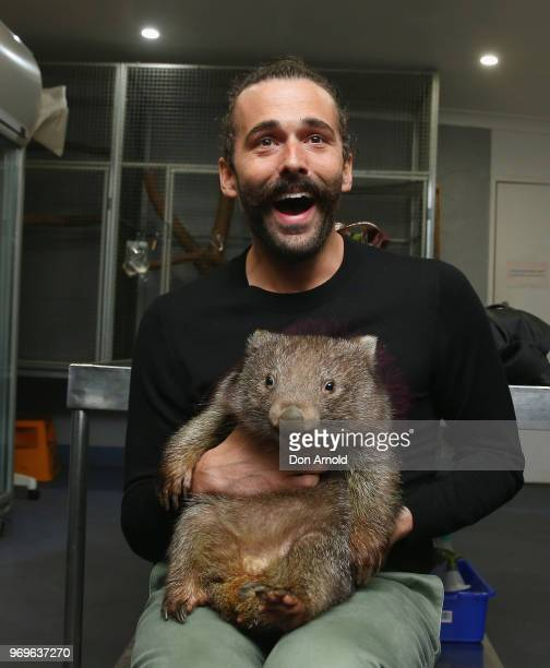 Jonathan Van Ness from Netflix's Queer Eye greets Fernando the Wombat at Featherdale Wildlife Park on June 8, 2018 in Sydney, Australia.