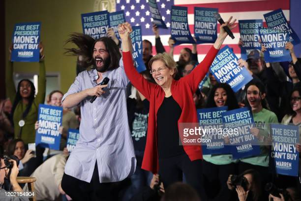 Jonathan Van Ness, of the Netflix series Queer Eye, introduces Democratic presidential candidate, Sen. Elizabeth Warren during a campaign rally at...