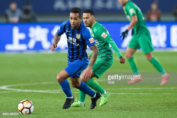 Jonathan Viera of Beijing Sinobo Guoan and Alex Teixeira of Jiangsu Suning vie for the ball during 2018 Ping An Chinese Football Association Super...