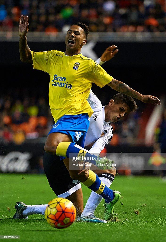 Jonathan Viera (20) of Las Palmas is tackled by Joao Cancelo of Valencia during the La Liga match between Valencia CF and UD Las Palmas at Estadi de Mestalla on November 21, 2015 in Valencia, Spain.