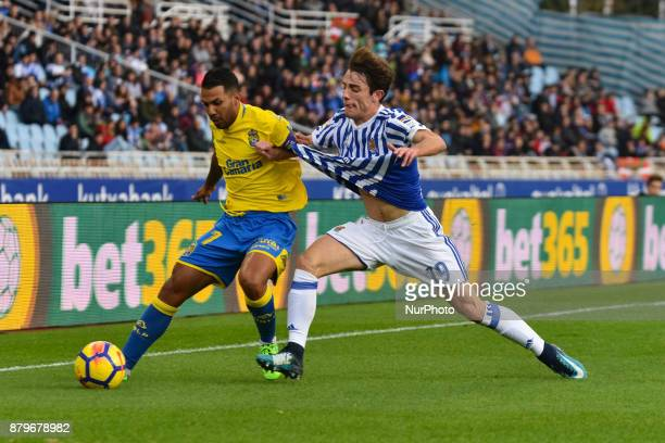 Jonathan Viera of U D Las Palmas duels for the ball with Alvaro Odriozola of Real Sociedad during the Spanish league football match between Real...
