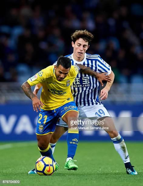Jonathan Viera of UD Las Palmas duels for the ball with Alvaro Odriozola of Real Sociedad during the La Liga match between Real Sociedad de Futbol...
