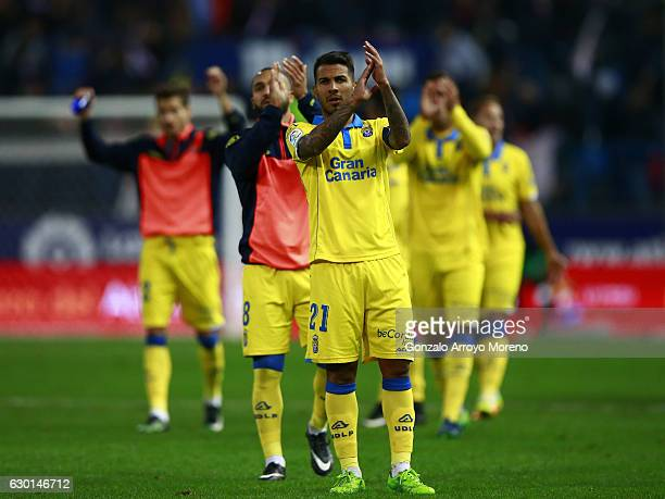 Jonathan Viera of UD Las Palmas greets the audience with his teammates after the La Liga match between Club Atletico de Madrid and UD Las Palmas at...