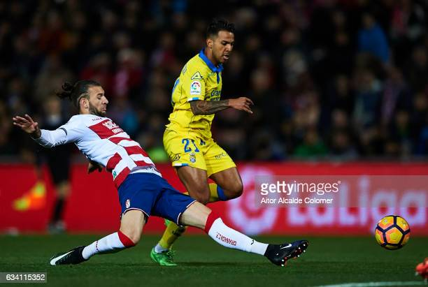 Jonathan Viera of Union Deportiva Las Palmas being followed by Gabriel Gaston Alexis Silva of Granada CF during the La Liga match between Granada CF...