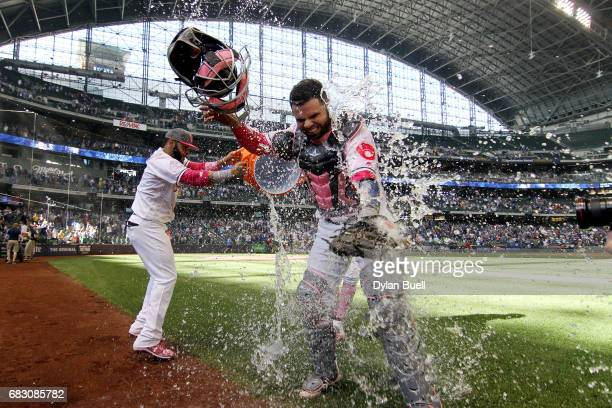 Jonathan Villar and Hernan Perez of the Milwaukee Brewers dump water on Manny Pina after defeating the New York Mets 119 at Miller Park on May 14...