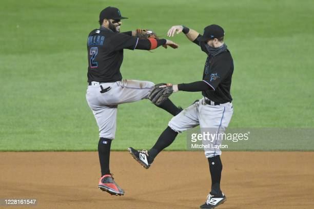 Jonathan Villar and Jon Berti of the Miami Marlins celebrates a win after game two of a doubleheader baseball game against the Washington Nationals...