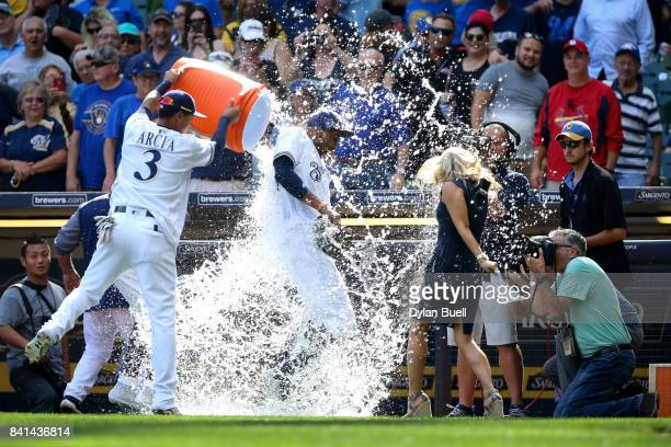 Jonathan Villar and Orlando Arcia of the Milwaukee Brewers dunk Keon Broxton with water after beating the St Louis Cardinals 65 at Miller Park on...