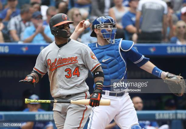 Jonathan Villar of the Baltimore Orioles reacts after striking out swinging in the eighth inning during MLB game action as Danny Jansen of the...
