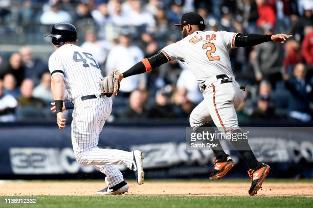 Jonathan Villar of the Baltimore Orioles tags Luke Voit of the New York Yankees to make the final out of the seventh inning of the game during...