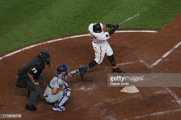 Jonathan Villar of the Baltimore Orioles watches his three run home run against the Los Angeles Dodgers during the seventh inning at Oriole Park at...