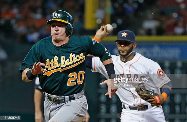 Jonathan Villar of the Houston Astros chases Josh Donaldson of the Oakland Athletics back to first base in the third inning at Minute Maid Park on...