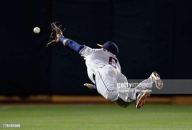Jonathan Villar of the Houston Astros dives but the ball is just out of his reach that goes for a base hit off the bat of Josh Donaldson of the...