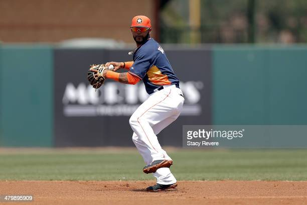 Jonathan Villar of the Houston Astros makes a throw to first base in the first inning of a game against the Philadelphia Phillies at Osceola County...