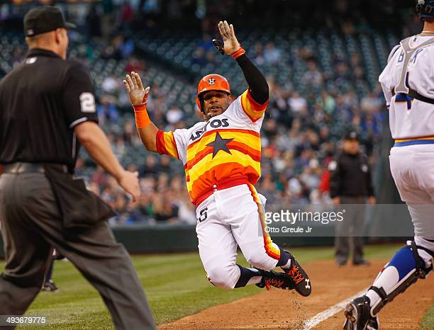 Jonathan Villar of the Houston Astros scores on a single by Jose Altuve in the fifth inning against the Seattle Mariners at Safeco Field on May 24...