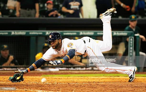 Jonathan Villar of the Houston Astros scores the winning run in the ninth inning against the Oakland Athletics at Minute Maid Park on July 23 2013 in...