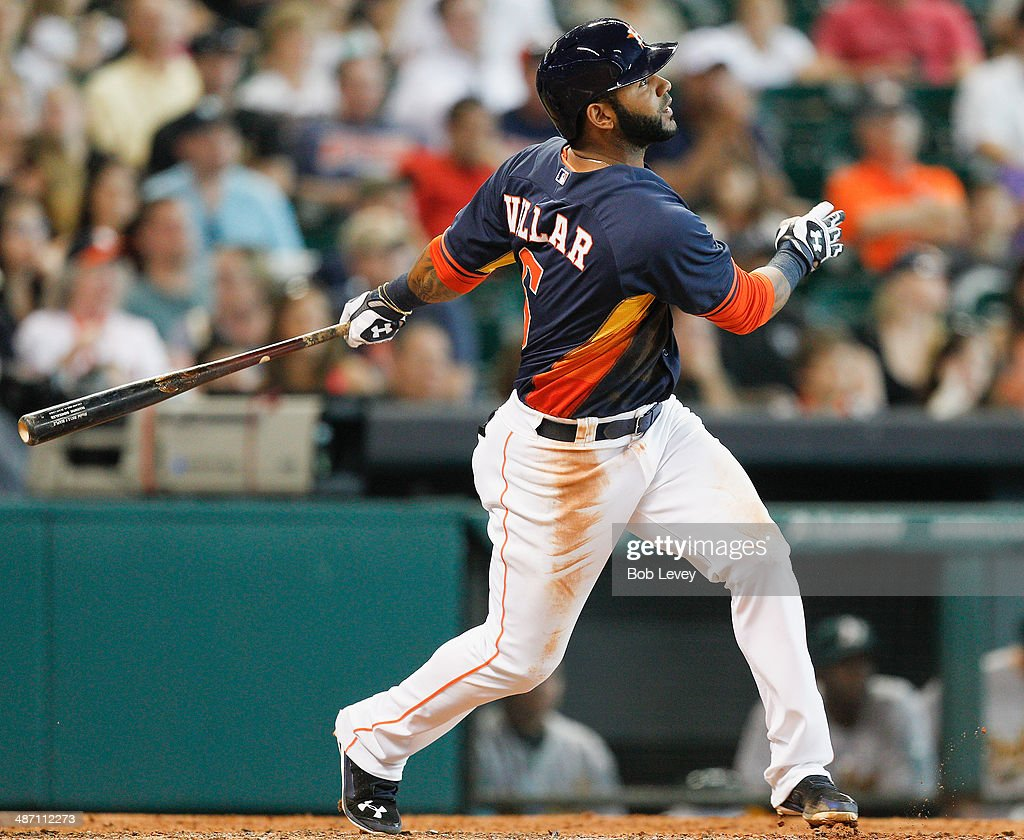 Jonathan Villar #6 of the Houston Astros triples in the sixth inning against the Oakland Athletics at Minute Maid Park on April 27, 2014 in Houston, Texas.