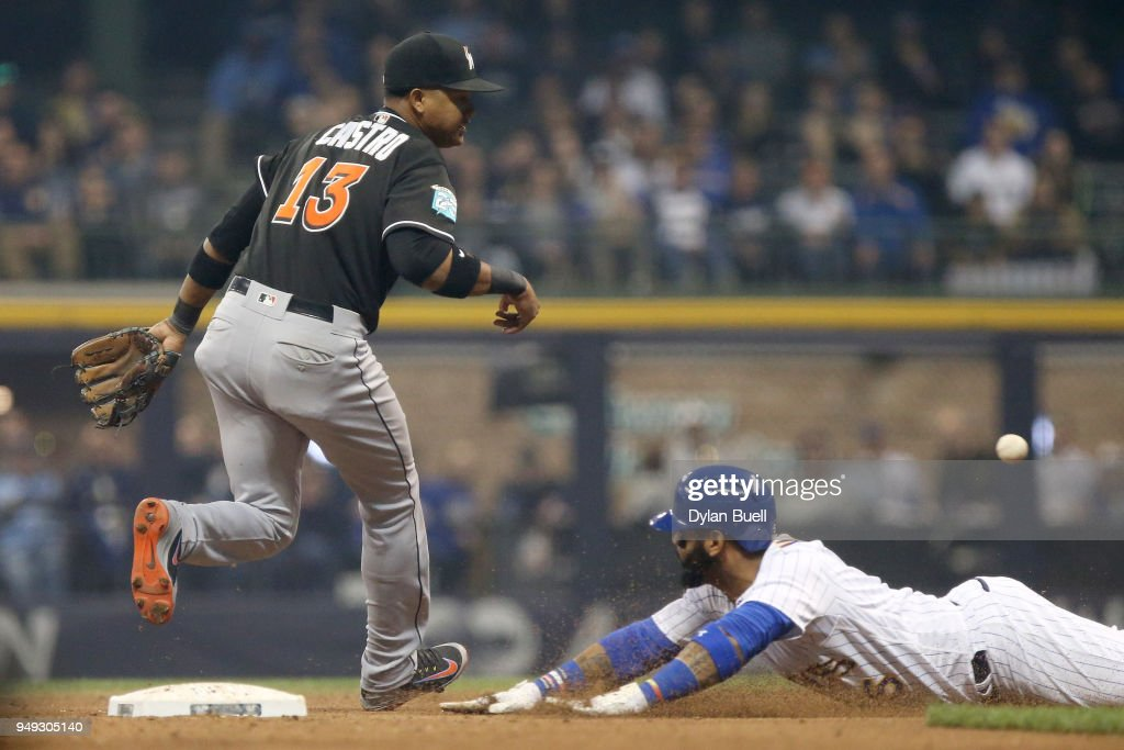 Jonathan Villar #5 of the Milwaukee Brewers advances to second base on a wild pitch past Starlin Castro #13 of the Miami Marlins in the fourth inning at Miller Park on April 20, 2018 in Milwaukee, Wisconsin.