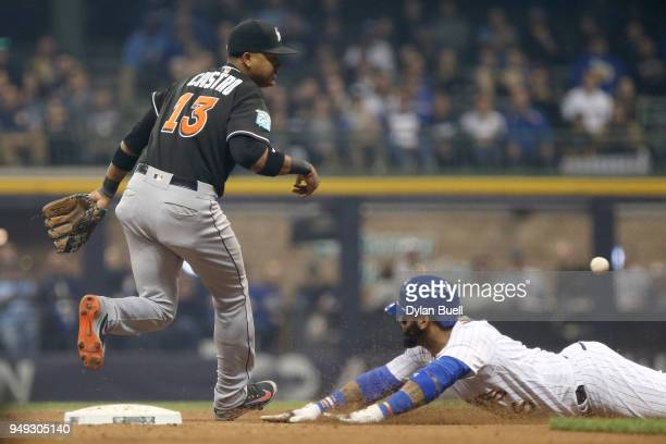 Jonathan Villar of the Milwaukee Brewers advances to second base on a wild pitch past Starlin Castro of the Miami Marlins in the fourth inning at...