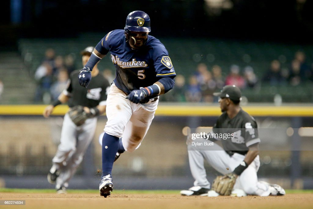 Jonathan Villar #5 of the Milwaukee Brewers advances to third base after an error by Gregory Infante #92 of the Chicago White Sox in the first inning during an exhibition game at Miller Park on March 31, 2017 in Milwaukee, Wisconsin.
