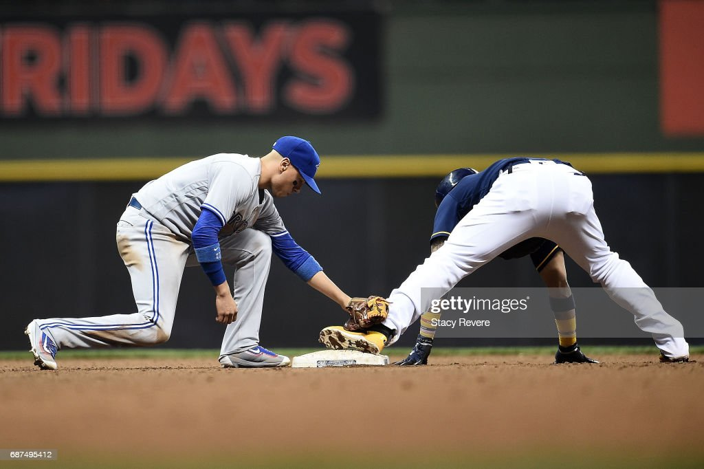 Jonathan Villar #5 of the Milwaukee Brewers beats the tag at second base by Ryan Goins #17 of the Toronto Blue Jays during the fifth inning of a game at Miller Park on May 23, 2017 in Milwaukee, Wisconsin.