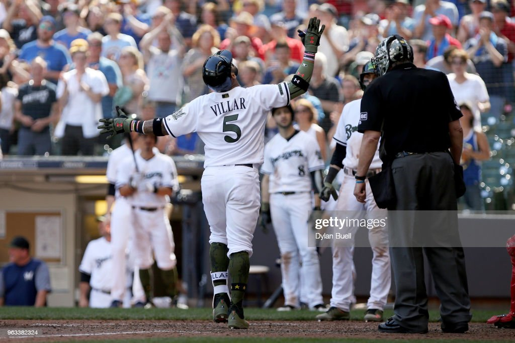Jonathan Villar #5 of the Milwaukee Brewers celebrates after hitting a home run in the seventh inning against the St. Louis Cardinals at Miller Park on May 28, 2018 in Milwaukee, Wisconsin. MLB players across the league are wearing special uniforms to commemorate Memorial Day.