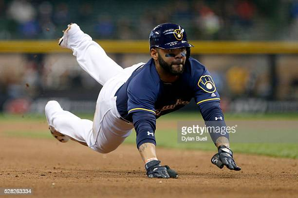 Jonathan Villar of the Milwaukee Brewers dives into third base in the fifth inning against the Los Angeles Angels of Anaheim at Miller Park on May 4...