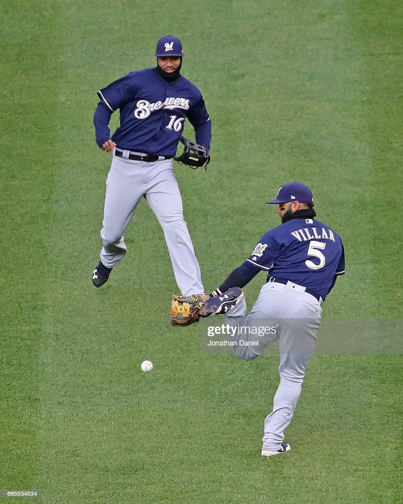 Jonathan Villar #5 of the Milwaukee Brewers drops a fly ball in front of teammate Domingo Santana #16 in the 9th inning against the Chicago Cubs at Wrigley Field on May 19, 2017 in Chicago, Illinois. The Brewers defeated the Cubs 6-3.